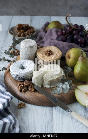 An arrangement of cheese with pears and nuts - Stock Photo