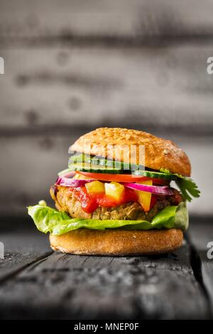 A gluten-free veggie burger - Stock Photo