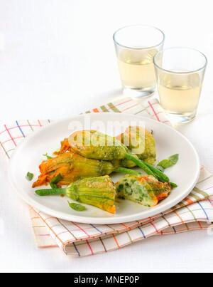Courgette flowers with a vegetarian filling - Stock Photo