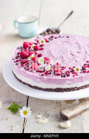 Raw cheesecake with a cashew and raspberry cream Stock Photo