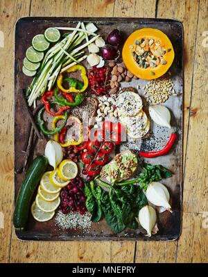 Various vegetables on a vintage tray Healthy greens - Stock Photo