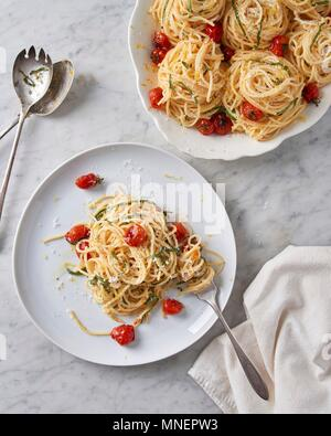 Spaghetti al limone with blistered cherry tomatoes - Stock Photo