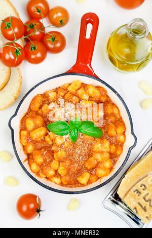 Mini gnocchi with tomato sauce and Parmesan - Stock Photo