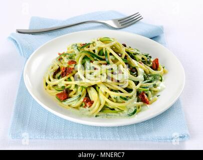 Spaghetti with courgette and olives - Stock Photo