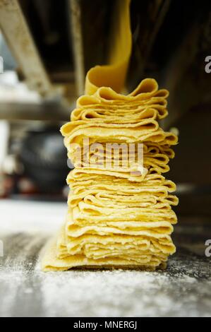 Fresh Sheets of Pasta Being Made - Stock Photo