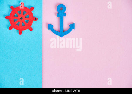 Decorative minimalistic card in pink and neon fashionable tones with the concept of the sea and rest. The sea details like an anchor, the helm. - Stock Photo