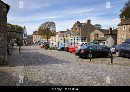 A sunny and inviting view of the village square of Grassington. Nr Skipton in Wharfedale, North Yorkshire - Stock Photo