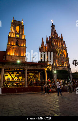 Clocktower and the Parish church of San Miguel, the emblem of the town at dusk,  San Miguel de Allende,  Bajío region, Central Mexico - Stock Photo