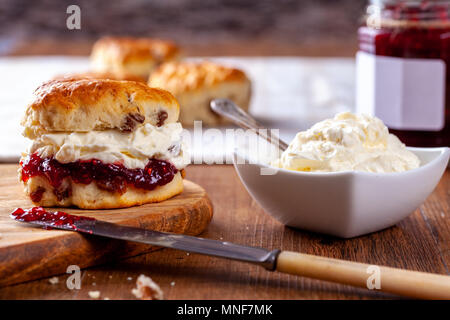 Scones with Strawberry Jam and Clotted Cream - Stock Photo