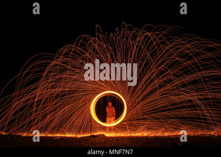 Long exposure shot taken at New River Junction in Virginia. The shot was taken using steel wool that was lit on fire. - Stock Photo
