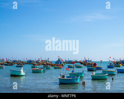 Fisherman Village Market with Basket Boats in Seascape at Mui Ne, Vietnam - Stock Photo