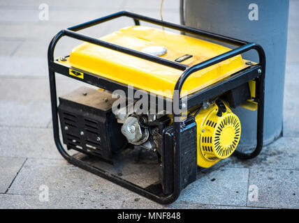 Gasoline Portable Generator on the House Construction Site. Close up on Mobile Backup Generator .Standby Generator - Outdoor Power Equipment - Stock Photo