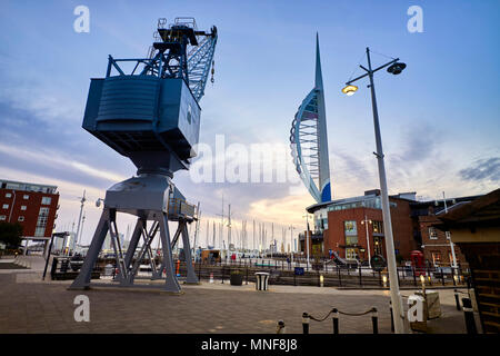 The dockside crane and spinnaker tower at Gunwharf Quays shopping centre in Portsmouth - Stock Photo