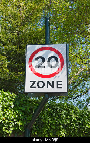20 miles per hour speed restriction sign England UK United Kingdom GB Great Britain - Stock Photo