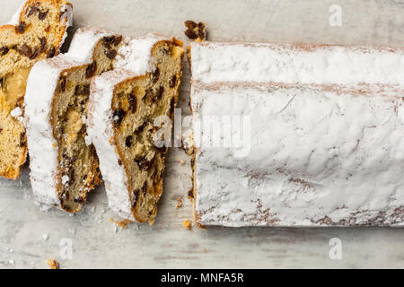 Traditional Christmas Stollen sliced - Stock Photo