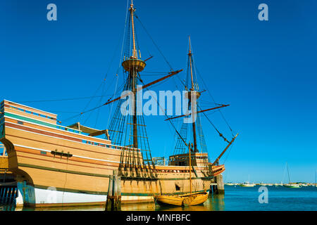 Plymouth, Massachusetts, USA - September 13, 2016:  The Mayflower II resides in the harbor, a replica of the 17th century Mayflower and it's dinghy. - Stock Photo