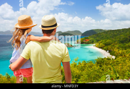 Family of father and daughter enjoying aerial view of picturesque Trunk bay on St John island - Stock Photo