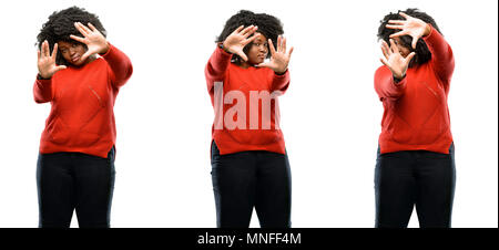 Young beautiful african plus size model confident and happy showing hands to camera, composing and framing gesture isolated over white background. Col - Stock Photo