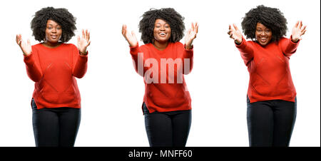 Young beautiful african plus size model confident and happy with a big natural smile welcome gesture isolated over white background. Collection compos - Stock Photo