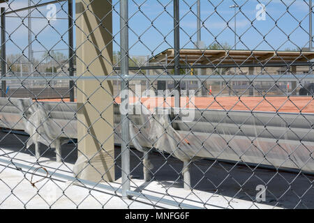 New softball field with benches still wrapped in plastic at Lake Prospect in Wheat Ridge Colorado - Stock Photo