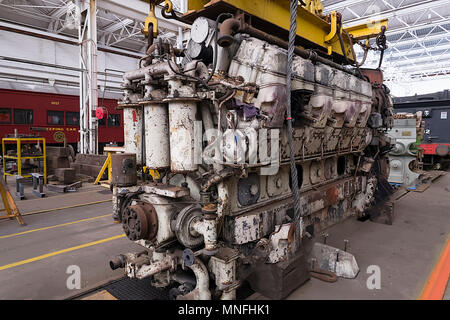 A huge diesel engine under maintenance in the railway workshops in Queensland - Stock Photo