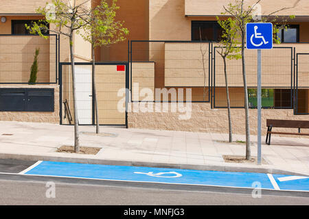 Restricted parking zone for disabled on a residencial urban area - Stock Photo