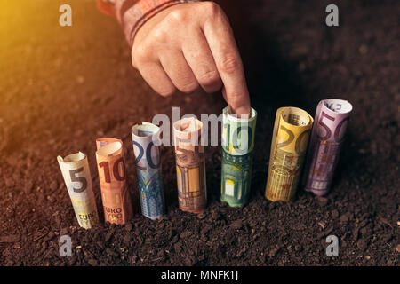 Euro bank loans for agricultural projects, productivity raising, biodiversity management and yield profit increasing - Stock Photo
