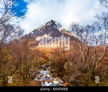 The famous pyramidal peak, Buachaille Etive Mor, seen from Dalness Woods, part of the Royal Forest, in the Highlands of Scotland - Stock Photo