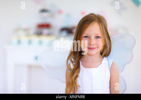 Adorable little fairy girl on a birthday party - Stock Photo