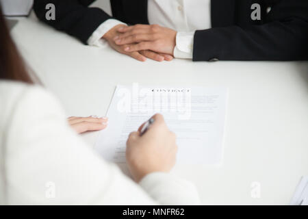 Close up of signing work contract - Stock Photo