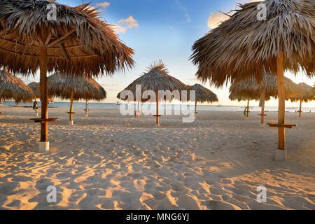 Amazing tropical holidays. Sun umbrellas on the beach. Tropical paradise. Caribbean. Punta Cana. Dominican Republic - Stock Photo