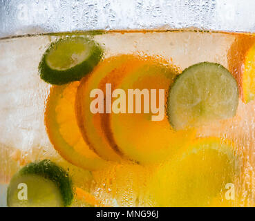 Orange and Lime Slices in Water - Stock Photo
