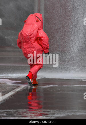 fireman with red protective gear against biological risk - Stock Photo
