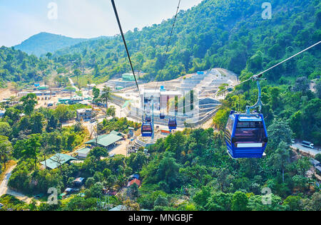 The cable car opens the view on the foot of Kyaiktiyo Mount - famous religious site of Buddhist pilgrims, visiting Golden Rock shrine there, Myanmar. - Stock Photo