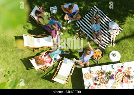Top view of friends having grill in garden - Stock Photo