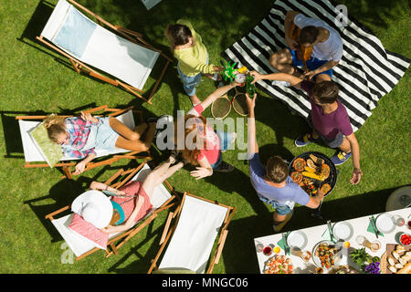 Friends having summer garden party, top view - Stock Photo