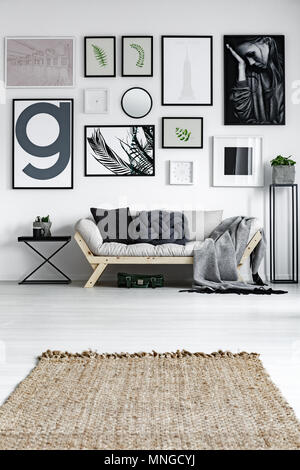 Modern living room in scandinavian style with wicker carpet - Stock Photo