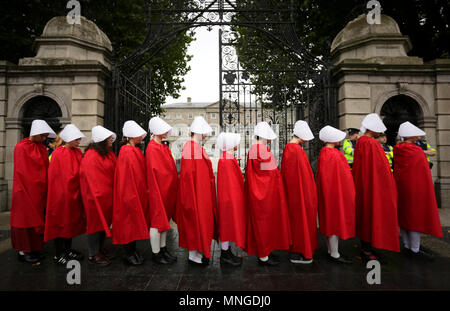 Dublin, Ireland. 20th September 2017.  A group of 'Handmaids' are pictured outside the gates of the Irish Parliament, Leinster House, in Dublin, today - Stock Photo