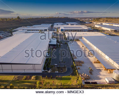 Exterior view of a modern industrial warehouse in a business park - Stock Photo