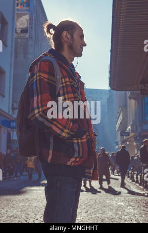 Istanbul, Turkey - January 06, 2018: Young male tourist walking in touristic Eminonu district of Istanbul city, Turkey - Stock Photo