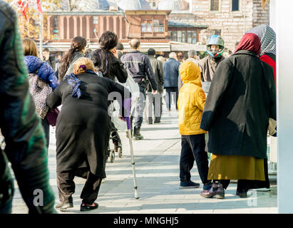 Istanbul, Turkey - January 06, 2018: People walking in touristic Eminonu district of Istanbul city, Turkey - Stock Photo