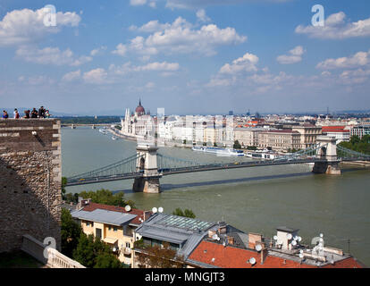 View of the Danube River and the Pest side of Budapest from the royal palace on Buda Hill, with the Hungarian Parliament building dominating the backg - Stock Photo