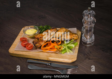 Fried chicken wings with sauce and salad - Stock Photo