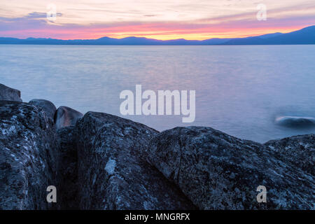 Sunset over  Lake Tahoe, Nevada, United States, on a summer day. - Stock Photo