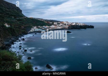 View towards Los Aguas village in dusk with illumination, Tenerife Island, Canary Islands, Spain - Stock Photo
