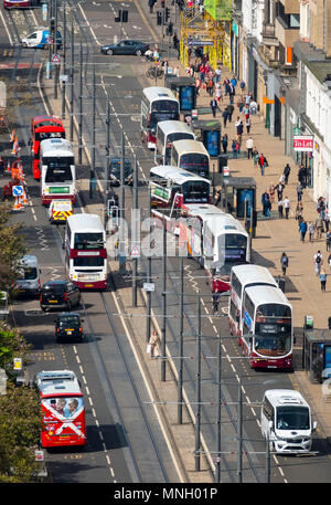 Busy public transport buses  traffic on Princes Street shopping street in central Edinburgh, Scotland, UK - Stock Photo
