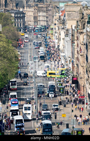 Busy traffic on Princes Street shopping street in central Edinburgh, Scotland, UK - Stock Photo