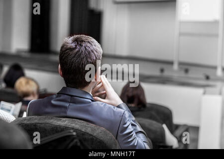 students of business courses sitting in the conference room for a business training - Stock Photo