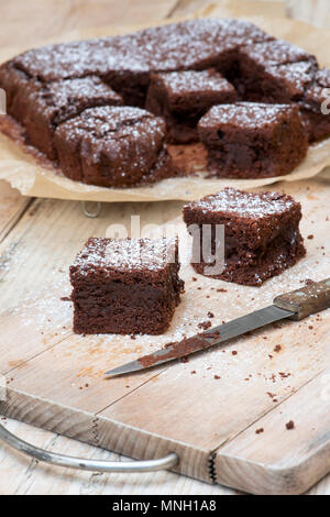 Homemade Chocolate Brownies on a wood background - Stock Photo
