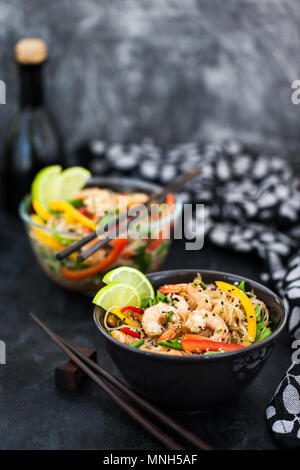 Delicious asian rice glass noodles with prawns and vegetables  (wok) - Stock Photo